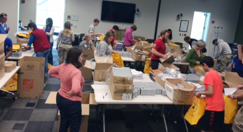 Volunteers packed over 3,000 backpacks for the STEP program