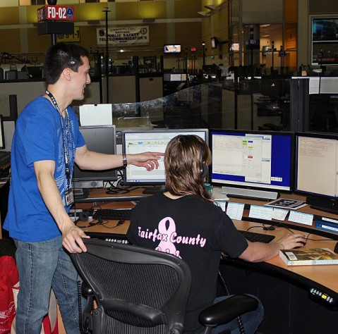 9-1-1 operators standing male and seated female